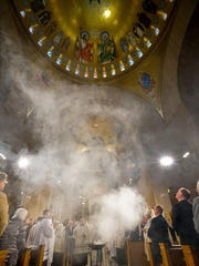 Incense rises to bless the Trinity Dome during the