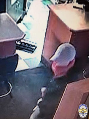 Keizer police are searching for two men suspected of robbing a Keizer bar early Monday morning.