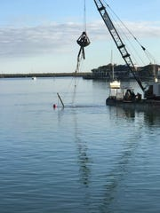 Collier Seawall & Dock removed a submerged sailboat