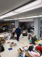Piles of donations came in after a fire displaced eight