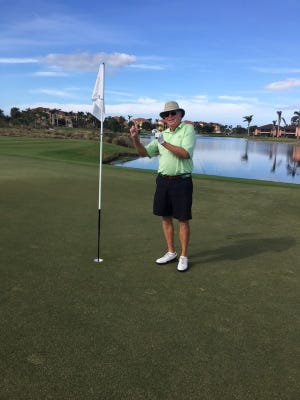 Naples' Roger Craycraft, with the ball he used for his first of two holes-in-one in three days, both on No. 7 on the Hammock Bay Course at The Members Club at Marco, on Sunday, Dec. 24.