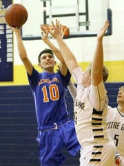 Nate Chorney of Thomas A. Edison puts up a shot as Elmira Notre Dame's Ben Cook, left, and Gary Raupers defend Dec. 12 at Notre Dame High School. Chorney scored 41 points in the loss.