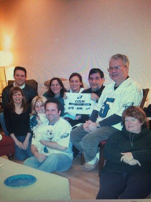 When the Eagles went to the Super Bowl in 2005, Thomas Stanuikynas of Delran (center, holding towel) watched the game with his daughters, Kristen Nicastro of Cherry Hill (left) and Carla Bossert of Medford (seated, holding dog). He would have loved this team, the women say.