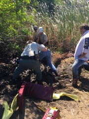 Brevard County Sheriff's Office animal services personnel rescue a horse from a Merritt Island ditch.