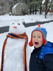 Eli Dunay, 2 years old, is enthralled by the snowfall
