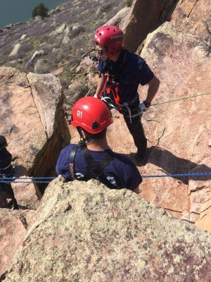 Crews rescue a man after a rock climbing fall near Horsetooth Reservoir on Sunday.
