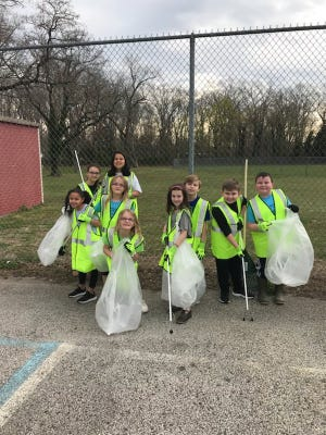 Students from Ellison School celebrated Earth Day by picking up trash at Pagliughi Park on Magnolia Road in Vineland.