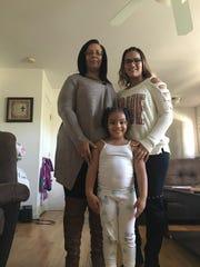 Left, Yolanda Cossentino and family