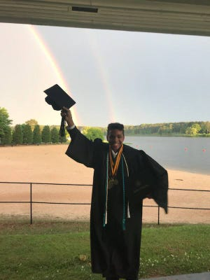 Matthew McKenzie, pictured here on May 10 — the day he graduated from both high school and college with an associate's degree — has a dream to become a biochemist who can cure wrinkles.