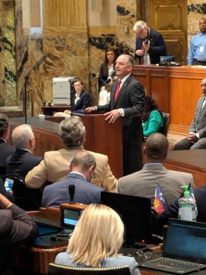 Gov. John Bel Edwards called Monday for the Legislature to put aside partisan politics and extend revenue measures to avoid cuts in state services.
