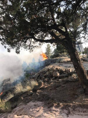 A growing wildfire in Central Oregon prompted an evacuation Thursday evening.