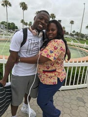Johnnie Lang with his mother Lakesha Scott before he