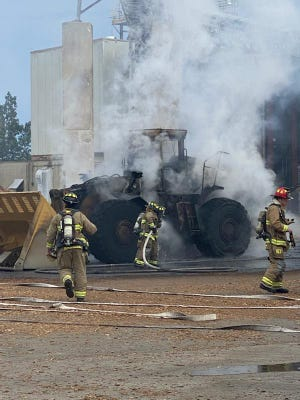 A fire at the Schiller Station power plant burned a large backloader Sunday.