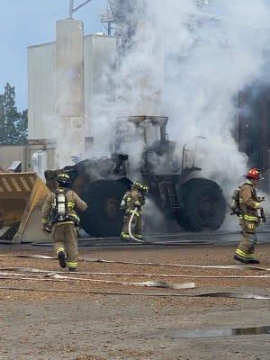 A fire at the Schiller Station power plant burned a large backloader Sunday.