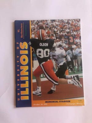 Former Freeport linebacker/defensive lineman/fullback/tight end David Olson is featured on the cover of an Illinois game day program. Olson played in all 47 games for the Illini from 1990-93.