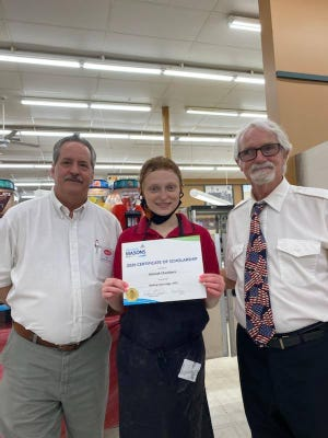 """Hannah Chambers (center) is presented the Belding-Ionia Masonic Lodge 2020 """"Helping Hand"""" scholarship. Pictured are Bro. Michael R. """"Mick Reynolds"""" (right), co-chairman of the Belding-Ionia 2020 Scholarship Committee, and Dan Renou, assistant store director of Leppinks in Belding."""