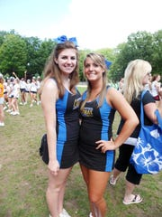 Kelly Parks (left) and Nicole Surace share a happy moment as Spotswood High School cheerleaders.