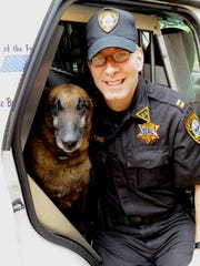 Tim Pino with Dano, his K9 partner.