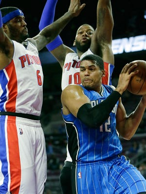 Pistons forwards Josh Smith, left, and Greg Monroe try to defend Magic forward Tobias Harris during Detroit's loss Monday at the Palace.
