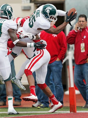 Michigan State wide receiver Macgarrett Kings Jr. scores against Indiana in the second half of MSU's 56-17 win Saturday in Bloomington, Ind.