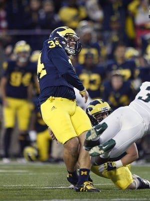 Michigan's Brendan Gibbons made the eventual game-winning field goal to beat Michigan State on Oct. 20, 2012.