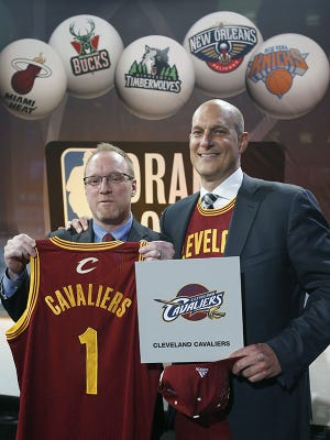 Cleveland Cavaliers general manager David Griffin, left, holds a Cavaliers jersey with the No. 1 displayed on it as he poses for a photo with Cavaliers minority owner Jeff Cohen following the NBA basketball draft lottery in New York, Tuesday, May 20, 2014. The Cavaliers continued their remarkable lottery luck Tuesday, winning the No. 1 pick in the NBA draft for the second straight year.