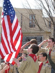 Boy Scouts from Troop #1559 raise the flag during the dedication Saturday.
