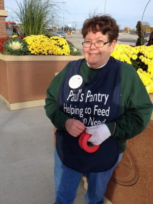 A Paul's Pantry volunteer takes donations during the Packers Women's Association's annual food drive before Sunday's Green Bay Packers-Carolina Panthers game at Lambeau Field.