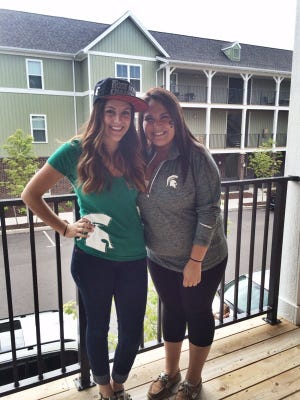 Francesca Weatherhead, 25, left, and her sister Nina Weatherhead attended the Michigan State University football opener in East Lansing last month. Francesca earned a marketing degree at MSU in 2010.