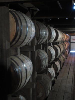 Bourbon supplies age in barrels at the Jim Beam distillery in Clermont, Ky. Kentucky bourbon makers have stashed away their largest stockpiles in more than a generation due to resurgent demand for the venerable brown spirit.