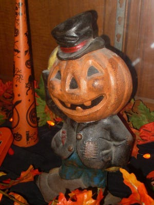 This pumpkin sporting a jaunty hat is actually a doorstop, and is part of the exhibit.