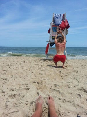 """""""My view for the day... bay watch dude ripping some squats and pushups. At least I offered him a cold one. #ocmd"""""""