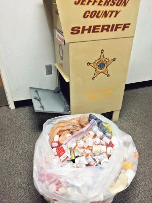 The contents of a Jefferson County, Ky., sheriff's prescription drug drop-off box are unloaded recently in Louisville.