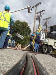 Consolidated Edison workers worked around the clock to fix a power supply outage on Sept. 27 that hit the New Haven line of the Metro-North Railroad.