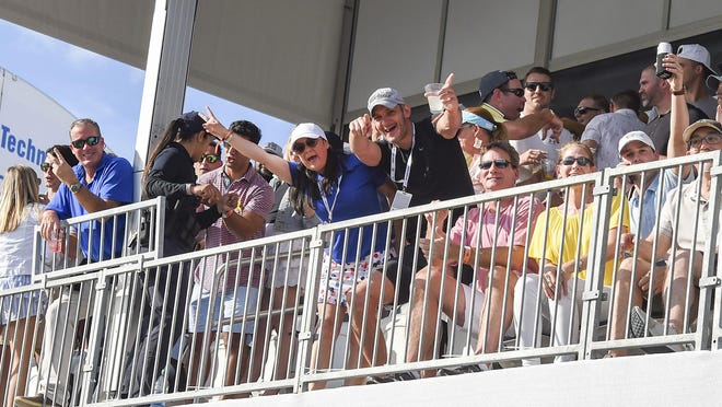 Fans pose for a picture at the 17th hole during the final round of the 2020 Honda Classic at PGA National Resort & Spa in Palm Beach Gardens. Attendance figures topped 200,000 for the fifth straight year.