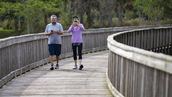 Andrew and Nicole O'Halloran, Wellington, hike along the boardwalk in the Wellington Environmental Preserve on April 29, 2020. Wellington's walking paths and preserves are among some of its most-used facilities, a consultant report recently found.