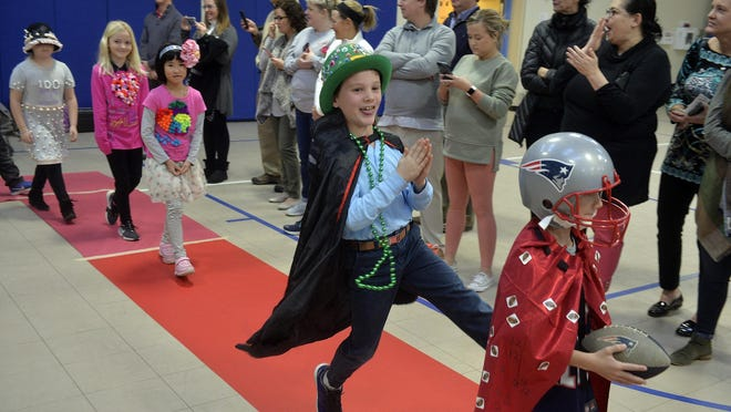 Students at St. Andrew's School walked down the runway in a fashion parade as they celebrated the 100th day of school in September 2019.