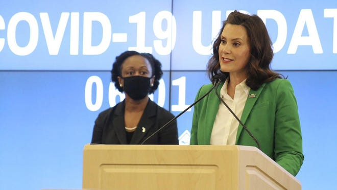 In this Monday, June 1, 2020 photo provided by the Michigan Office of the Governor, Michigan Gov. Gretchen Whitmer speaks during a news conference in Lansing.