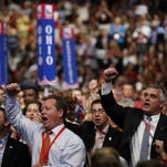 Delegates react as Republican presidential nominee Mitt Romney speaks at the 2012 Republican National Convention in Tampa, Fla.