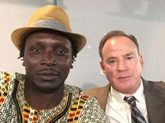 Phoenix activist S. Otieno Ogwel (left) and Phoenix police Chief Joe Yahner attended a conference in Washington, D.C., together in 2015.