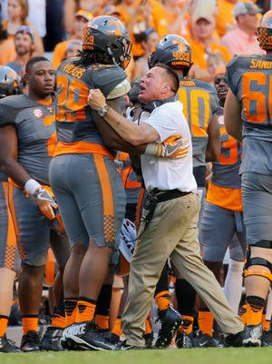 Tennessee Volunteers head coach Butch Jones and defensive lineman Kendal Vickers (39) during the second half against the Florida Gators at Neyland Stadium.