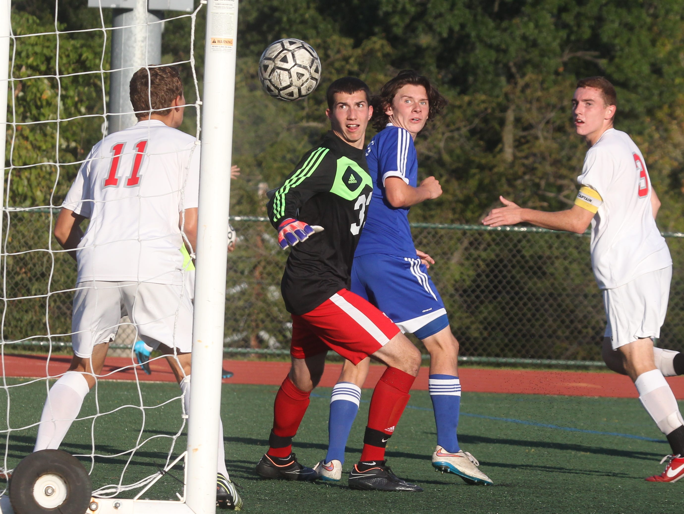 Tappan Zee goalie John Connor watches the ball go into the net, but it didn't count since it went in directly from a throw-in Sept. 24, 2015. Pearl River won1-0.