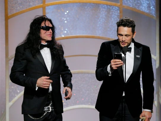 Tommy Wiseau, left, joins James Franco, who won the