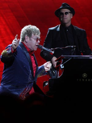 Elton John and his band perform during the Final Curtain tour at the Denny Sanford Premier Center on Fri., Oct. 2, 2015.