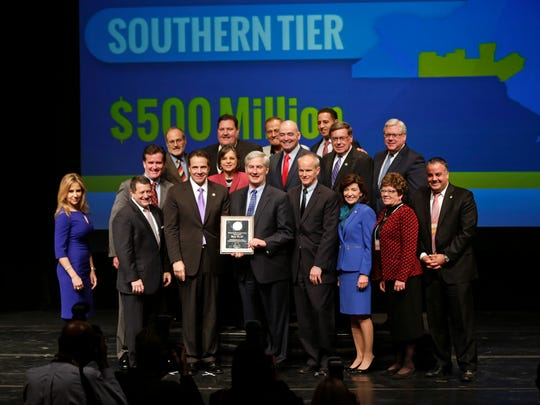 New York Gov. Andrew Cuomo poses with representatives of the Southern Tier Regional Economic Development Council during an economic development awards ceremony on Thursday in Albany.