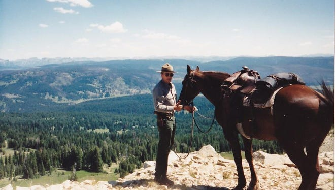 Ranger Jerry Mernin and Scott overlook part of the South District in Yellowstone National Park.