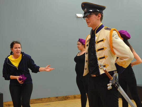 """Gabrielle Alexander, 21, and Jared Zipp, 20, act out """"The Military"""" scene during a Peter Quince Performing Company rehearsal  at Treehouse Theatre in Manitowoc on Tuesday. Alexander plays the lead role of JoJo, which is typically played by a young boy but has been adjusted for the Treehouse production."""