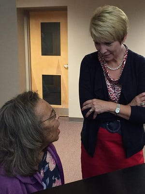 Lt. Gov. Sue Ellspermann talks with Hand-in-Hand Adult Day Care participant Eloise Embry after Embry played the piano for Ellsperman and officials from the Family and Social Services Administration, who visited the center and two other Richmond locations Friday.