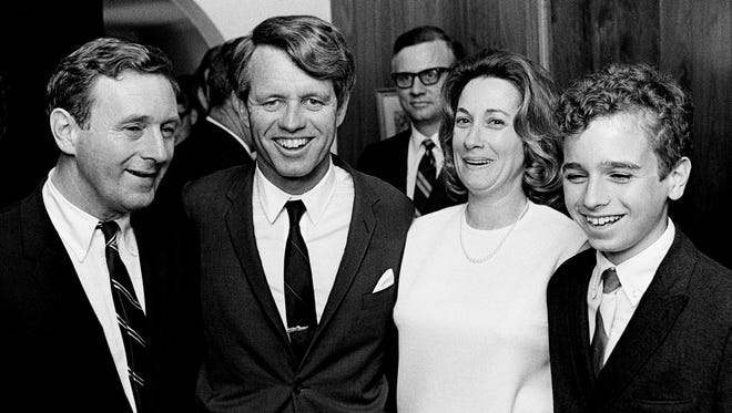 Presidential aspirant Sen. Robert Kennedy, second from left, pose with the family of The Tennessean Editor John Seigenthaler, left, and wife Dolores and son John Michael, at Vanderbilt University March 21, 1968. Seigenthaler was a former administrative assistant when Kennedy was the U.S. Attorney General. Sen. Kennedy is getting ready to speak at the Impact Symposium at Vanderbilt.