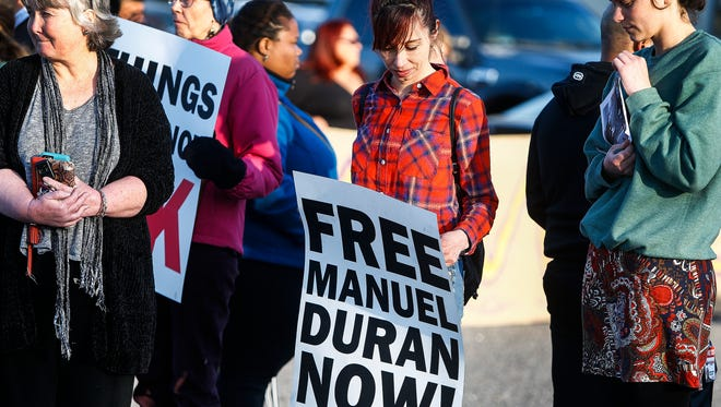 Community members attend a April 10, 2018 vigil outside El Mercadito de Memphis in Hickory Hill to support Manuel Duran. The reporter for Spanish-language media was arrested April 3, 2018 while doing a live Internet video of a Memphis protest. Duran has since been transferred to an immigration detention center in Louisiana.